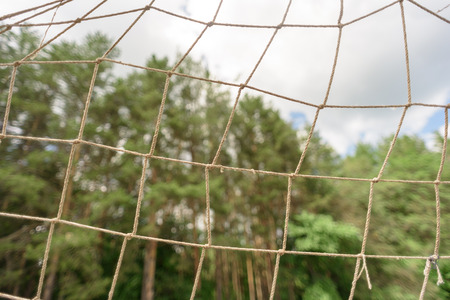 netting: Simple string netting of a football soccer goal. Copy space area for sports based concepts and designs.