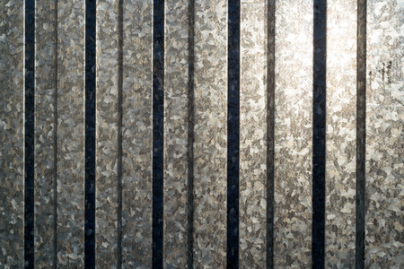hardened: Aluminium sheeting in vertical with sunlight reflecting off the metal surface