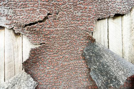 bitumen: Cracked and peeling aged bitumen waterproofing coat on wood Stock Photo