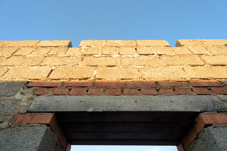 workmanship: House interior brick walls under construction and showing new building work and bricklaying