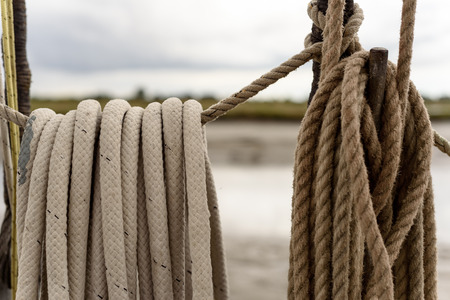 Ordered rope rigging of a boat tied up neatly in a loop Stock Photo