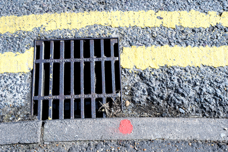 metal grate: Storm Drain Grill and Double Yellow Painted Lines