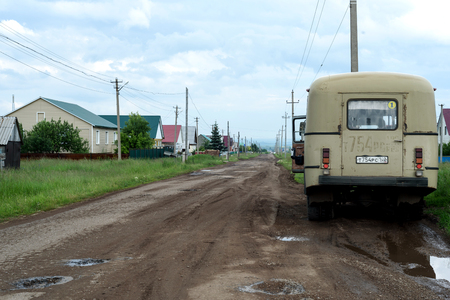 grimy: Vintage Russian bus waits at a public bus-stop for people before disembarking Editorial