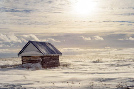 Aged wooden hut or shed in a snowy wintry landscape Stock Photo