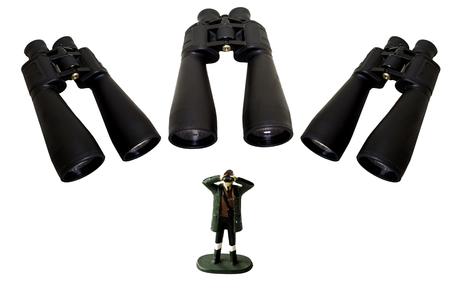 Three binoculars watch a man spying with a pair of hand-held binos Stock Photo