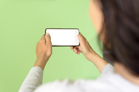 Woman holding a Smart Phone device with clipping path for VR augmented reality overlays Stock Photo