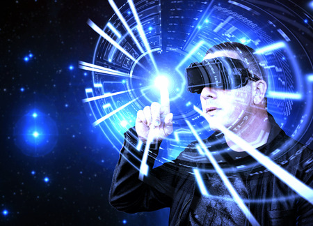 interacts: Man wearing VR Virtual Reality headset interacts with a blue neon HUD augmented reality data screen
