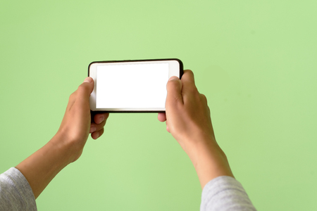 Woman holding a Smart Phone device with clipping path for VR augmented reality overlay