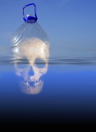Pollution themed design of a plastic PET drinking container floating in sea water with a human skull submerged beneath the environment