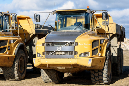 parked Volvo A30F earth moving machines at a local gravel pit in Essex Silver End England