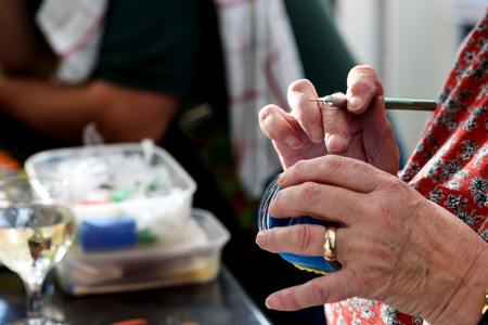 Elderly womans hands using a scapel to craft with modelling clay