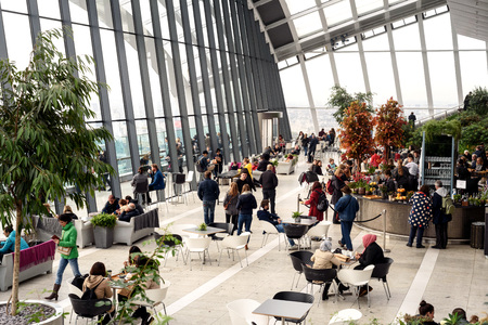 People inside viewing the free Sky Garden cafe on the 35th floor of 20 Fenchurch Street in London