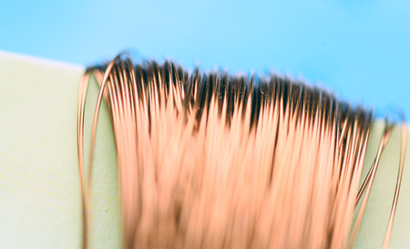Macro image of copper wire with a defocused background highlighting the fragile strands of this malleable metal