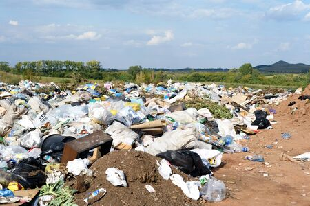 RAEVKA, RUSSIA - SEPTEMBER 9, 2018: A local rubbish tip full of waste that  awaits buria as part of the local landfill site for disposing of peoples household trash in Russial Publikacyjne