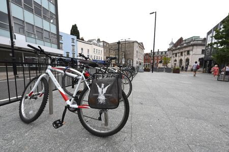CHELMSFORD, ESSEX/ENGLAND - 18TH AUGUST 2018: Parked locked cycles in the busy Duke Street area of Chelmford provide commuters and people with cheap and ergonimical travel