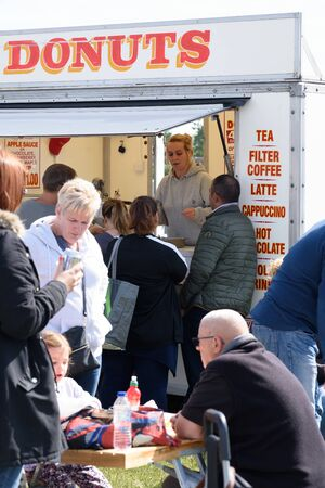 CHELMSFORD, ESSEX/ENGLAND - 1ST JUNE 2019 - People visiting a car boot sale in Boreham Essex buying fast food bugers and donuts and where they can also buy cheap and unusual items during the summer of 2019 Publikacyjne