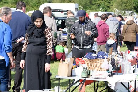 CHELMSFORD, ESSEX/ENGLAND - 1ST JUNE 2019 - People visiting a car boot sale in Boreham Essex where they can buy cheap and unusual items during the summer of 2019