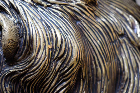 Bronze carving details in closeup macro view with attention to the strikes and curves of bronze and molten lead forming a unique pattern in metal Zdjęcie Seryjne