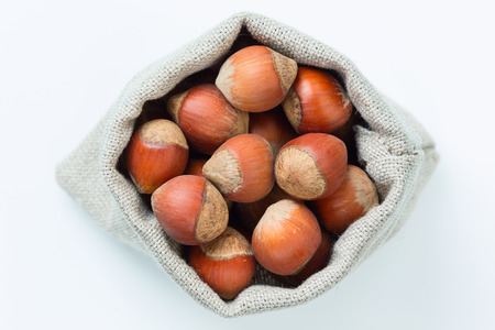 linen bag: Hazelnuts in the linen bag isolated
