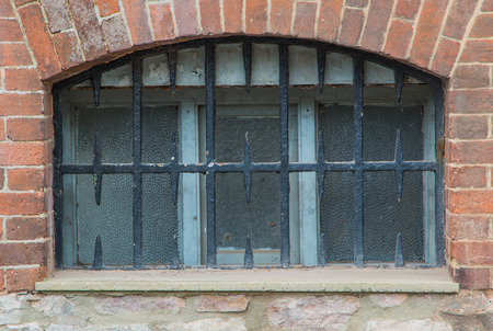 stippled: Window protected by decorative cast iron bars