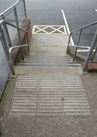 treads: safety treads and anti slip paving used in conjunction with steel handrails to create a safe stairway. Stock Photo