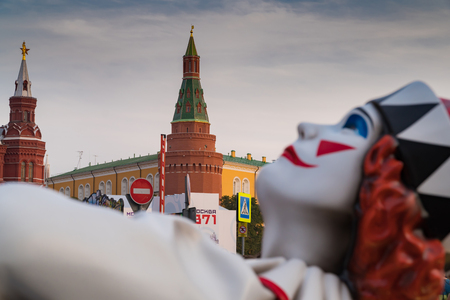 Statue of a clown on the background of the corner Arsenal tower of the Kremlin. Holiday on the occasion of 871 anniversary of Moscow