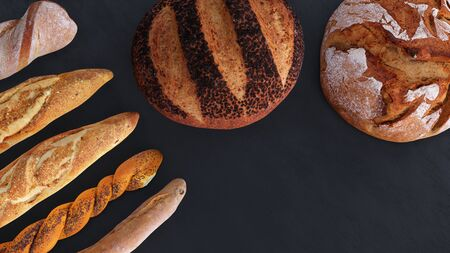 Different types of bread and rolls in the top view. Kitchen or bakery poster design on dark.