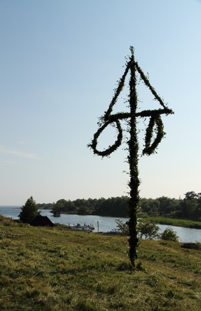 Backlit midsummer pole in the swedish archipelago. Stock Photo - 7666998