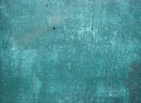 worn peeling blathering turquoise paint on wood