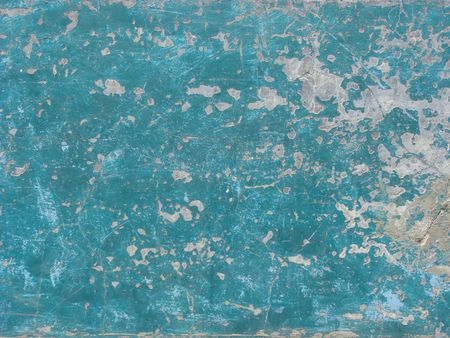 wall decor: worn blue painted wall with paint chip crack and blathering