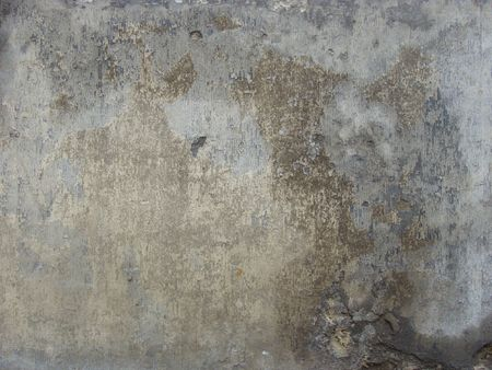 damaged cement: dirty gray beige worn damaged cement wall                                   Stock Photo
