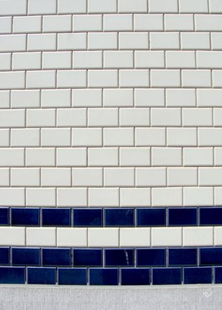 blue white tile pattern on a wall                                 photo