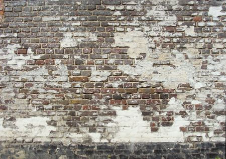 damaged worn green white painted brick wall