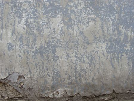 worn gray  painted wall with damage and blathering Stock Photo - 7136470