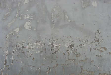 worn beige gray  painted wall with paint chip and remains of tag                                  Stock Photo - 7151385