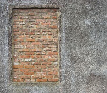 brick filled window on stucco concrete dirty worn wall                                Stock Photo - 7151394