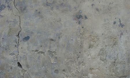 worn stone beige gray wall with dirt ,some left paint and vertical crack                                                            Stock Photo - 7151392