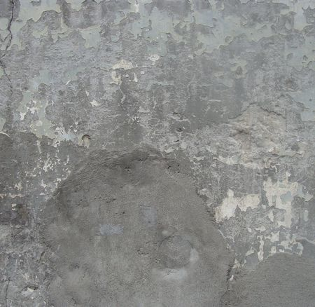 worn gray wall with peeling blue damaged paint  Stock Photo - 7160955