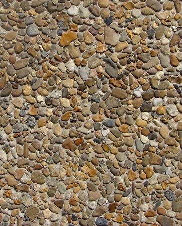 concrete with gray white orange brown stone pebbles wall  Stock Photo - 7172130