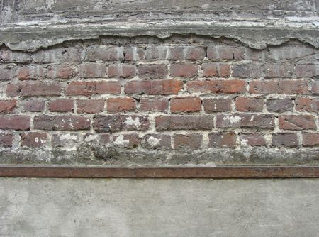 old damaged concrete wall with brick showing                                Stock Photo - 7196521