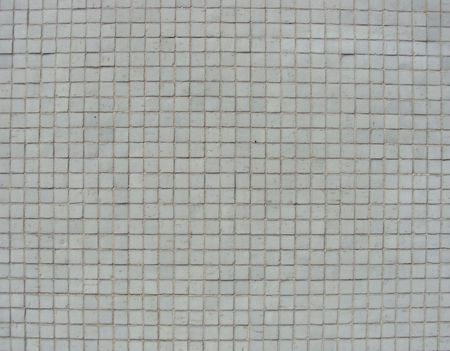 small white mosaic tiles on a wall