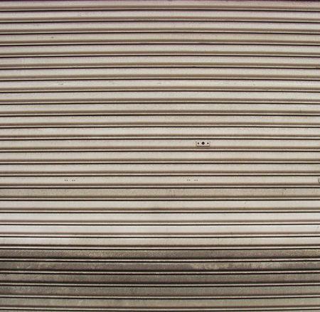 worn metal garage door gate store roller shutter                                                                Stock Photo - 7452323
