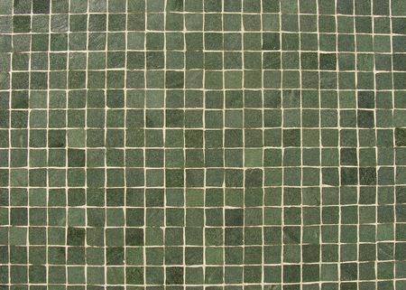 green tiles mosaic pattern on a wall