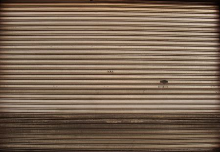 wide worn metal garage door gate store roller shutter                                                                photo