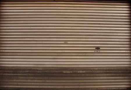 security shutters: wide worn metal garage door gate store roller shutter