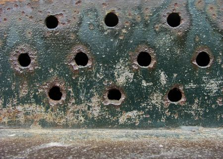 worn rusty metal air exit from a ventilation shaft                                photo