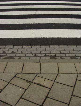 slightly wet side walk with zebrapath on a rainy day photo