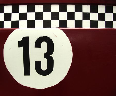 the number 13 in a race car like checker pattern                                photo
