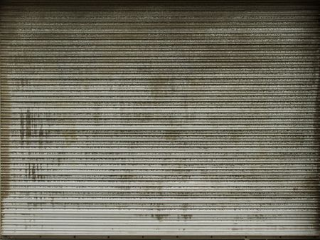 very dirty plastic roller shutter                                photo