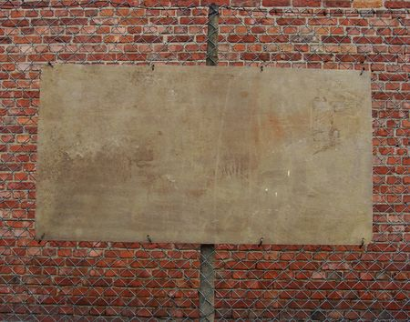 empty wooden plank board hanging on a fence                                Stock Photo